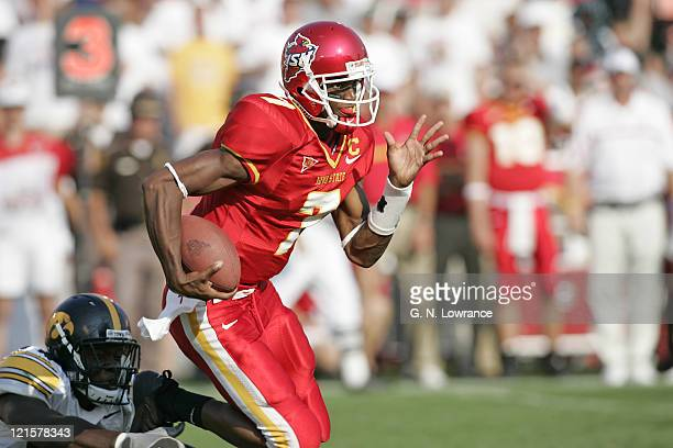 Quarterback Bret Meyer of the Iowa State Cyclones runs for yardage during a game against the Iowa Hawkeyes at Jack Trice Stadium in Ames Iowa on Sept...