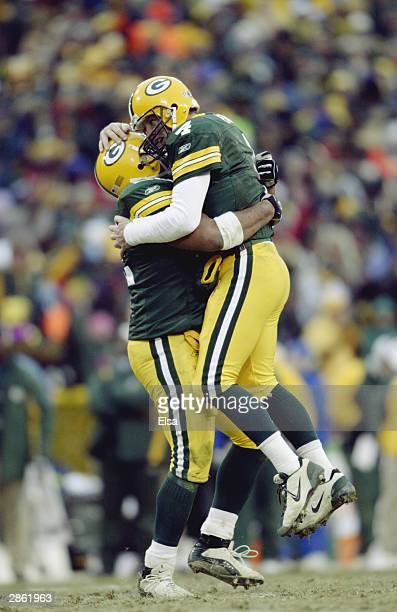 Quarterback Brett Favre and fullback Nick Luchey of the Green Bay Packers hug during the NFC playoff game against the Seattle Seahawks on January 4...