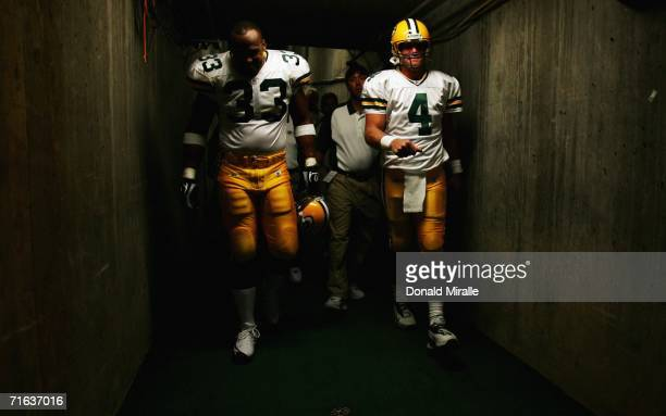 Quarterback Brett Favre and Fullback William Henderson of the Green Bay Packers enter the game from the stadium tunnel during their team's NFL...