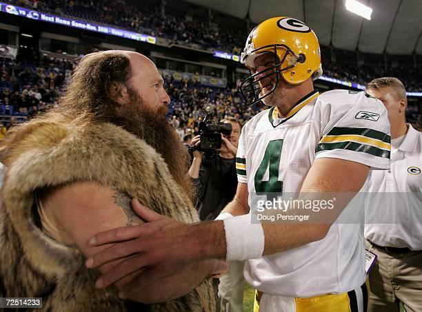Quarterback Brett Favre of the Green Bay Packers bids farewell to 'Ragnar' the Minnesota Vikings mascot portrayed by Joe Juranitch after the Packers...