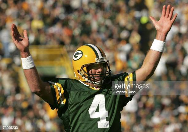 Quarterback Brett Favre of the Green Bay Packers celebrates after the Packers scored their third touchdown in the first half against the Arizona...