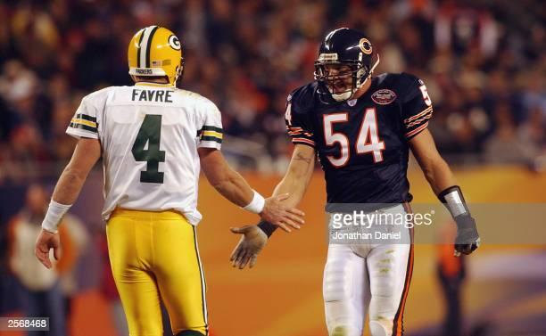 Quarterback Brett Favre of the Green Bay Packers congratulates linebacker Brian Urlacher of the Chicago Bears on September 29 2003 at Soldier Field...