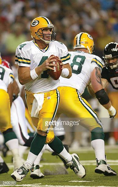 Quarterback Brett Favre of the Green Bay Packers drops back to pass against the Atlanta Falcons on August 9, 2003 at the Georgia Dome in Atlanta,...