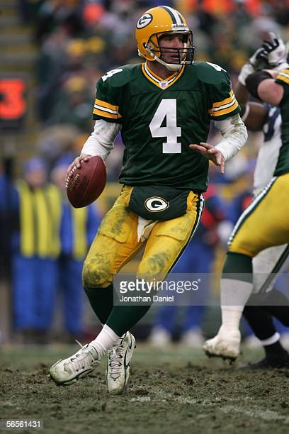 Quarterback Brett Favre of the Green Bay Packers drops back to pass against the Seattle Seahawks on January 1 2006 at Lambeau Field in Green Bay...