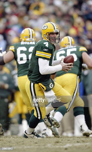 Quarterback Brett Favre of the Green Bay Packers hands the ball off during the NFC playoff game against the Seattle Seahawks on January 4, 2004 in...