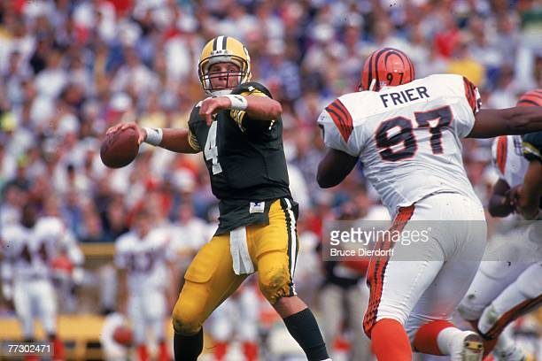 Quarterback Brett Favre of the Green Bay Packers is congratulated by teammates on the bench against the Cincinnati Bengals at Lambeau Field on...