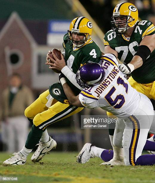 Quarterback Brett Favre of the Green Bay Packers is sacked by Lance Johnstone of the Minnesota Vikings as Chad Clifton tries to block in NHL action...