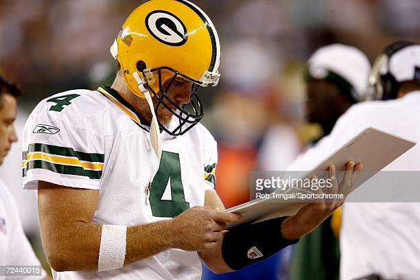 Quarterback Brett Favre of the Green Bay Packers looks at his playbook in a game against the Philadelphia Eagles on October 2, 2006 at Lincoln...