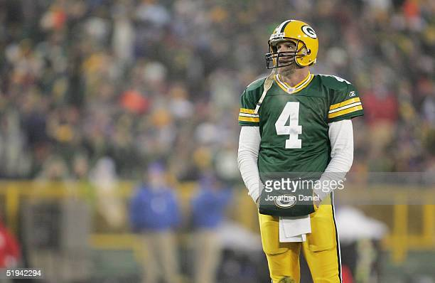 Quarterback Brett Favre of the Green Bay Packers looks dejected after throwing an interception against the Minnesota Vikings in the NFC wild-card...
