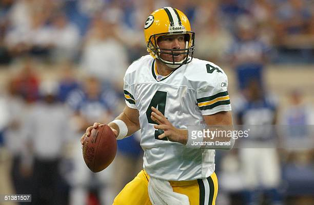 Quarterback Brett Favre of the Green Bay Packers looks for an open receiver during the game against the Indianapolis Colts at the RCA Dome on...