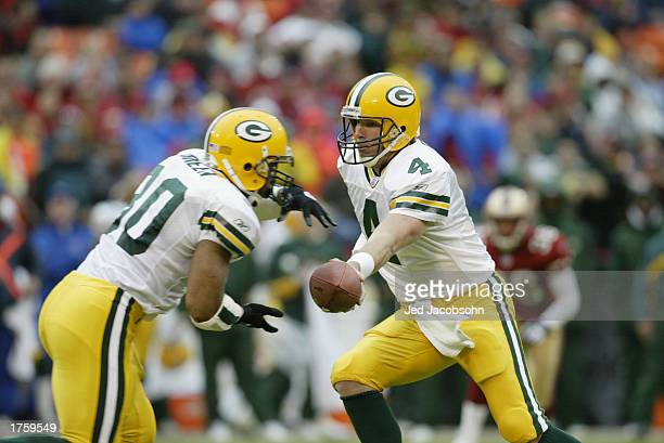 Quarterback Brett Favre of the Green Bay Packers motions for the handoff to running back Ahman Green during the NFL game against the San Francisco...