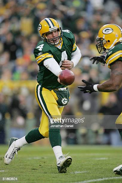 Quarterback Brett Favre of the Green Bay Packers prepares to handoff during the game against the Minnesota Vikings at Lambeau Field on November 14...