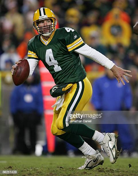 Quarterback Brett Favre of the Green Bay Packers rolls out of the pocket in search of a receiver in NFL action against the Minnesota Vikings November...