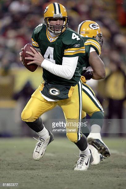 Quarterback Brett Favre of the Green Bay Packers rolls out of the pocket against the Detroit Lions at Lambeau Field on December 12 2004 in Green Bay...