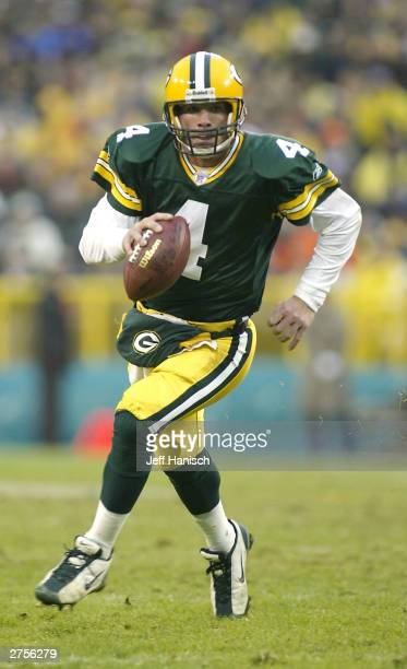 Quarterback Brett Favre of the Green Bay Packers scrambles for a first down against the San Francisco 49ers during the NFL game on November 23 2003...