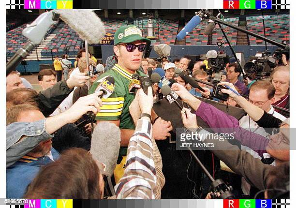 Quarterback Brett Favre of the Green Bay Packers talks to reporters 21 January during media day at the Louisiana Superdome in New Orleans Louisiana...