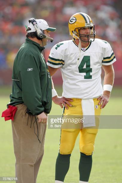 Quarterback Brett Favre of the Green Bay Packers talks with head coach Mike McCarthy after the third quarter against the San Francisco 49ers at...