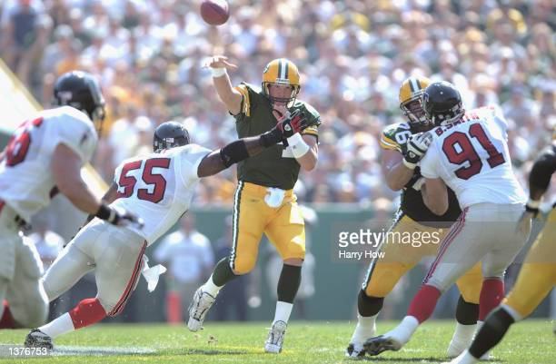 Quarterback Brett Favre of the Green Bay Packers throws from the pocket against the Atlanta Falcons during the game on September 8 2002 at Lambeau...
