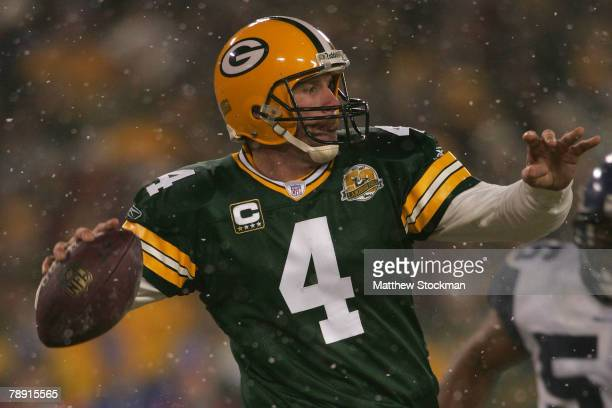 Quarterback Brett Favre of the Green Bay Packers throws the ball in the fourth quarter against the Seattle Seahawks during the NFC divisional playoff...
