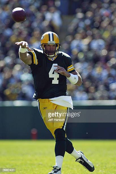 Quarterback Brett Favre of the Green Bay Packers throws the football in a game against the Seattle Seahawnks on October 5 2003 at Lambeau Field in...