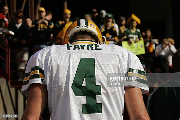 Quarterback Brett Favre of the Green Bay Packers walks back to the locker room after warming up for a game against the San Francisco 49ers on...