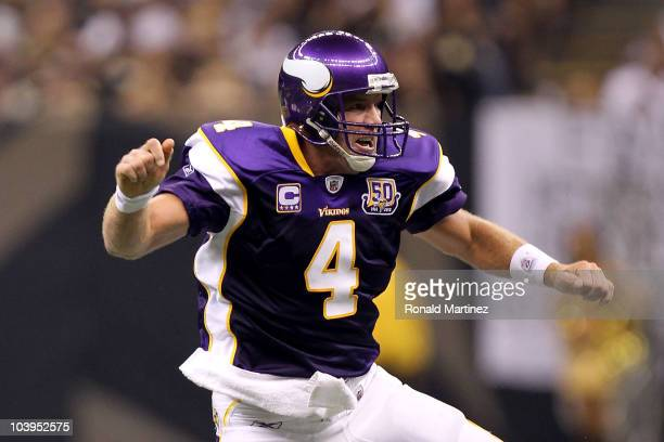 Quarterback Brett Favre of the Minnesota Vikings celebrates after he threw a 20yard touchdown pass in the second quarter to Visanthe Shiancoe against...