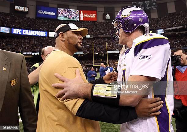 Quarterback Brett Favre of the Minnesota Vikings congratulates former Saints running back Deuce McAllister after the New Orleans Saints won 3128 in...
