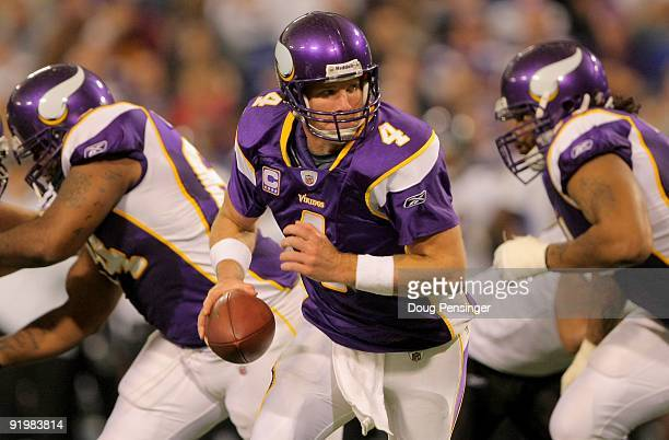 Quarterback Brett Favre of the Minnesota Vikings hands off the ball against the Baltimore Ravens during NFL action at Hubert H Humphrey Metrodome on...