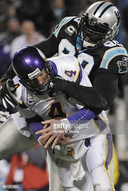 Quarterback Brett Favre of the Minnesota Vikings is sacked by Julius Peppers of the Carolina Panthers during a NFL game at Bank of America Stadium on...