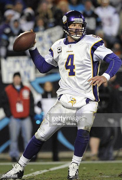 Quarterback Brett Favre of the Minnesota Vikings looks for a receiver during a NFL game against the Carolina Panthers at Bank of America Stadium on...