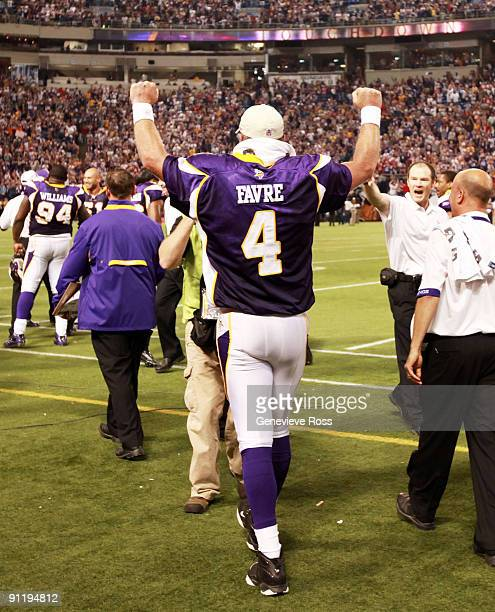 Quarterback Brett Favre of the Minnesota Vikings pumps his fists in celebration after defeating the San Francisco 49ers 27-24 at Hubert H. Humphrey...