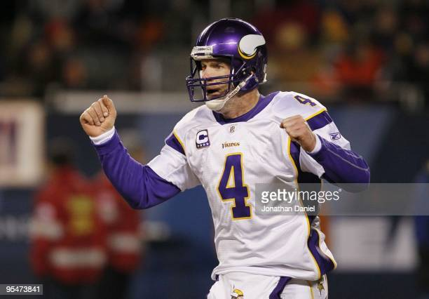 Quarterback Brett Favre of the Minnesota Vikings reacts after the Vikings score on an Adrian Peterson third quarter touchdown against the Chicago...