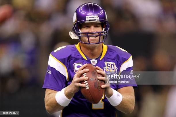 Quarterback Brett Favre of the Minnesota Vikings smiles as he warms up against the New Orleans Saints at Louisiana Superdome on September 9 2010 in...