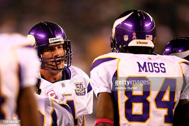 Quarterback Brett Favre of the Minnesota Vikings talks with Randy Moss in the huddle during warm ups against the New York Jets at New Meadowlands...