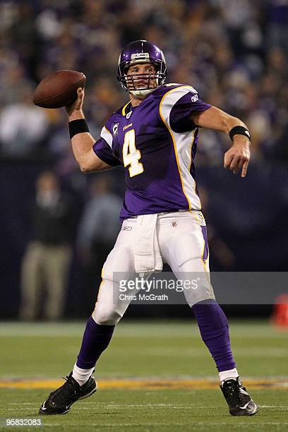 Quarterback Brett Favre of the Minnesota Vikings throws a pass against the Dallas Cowboys during the fourth quarter of the NFC Divisional Playoff...