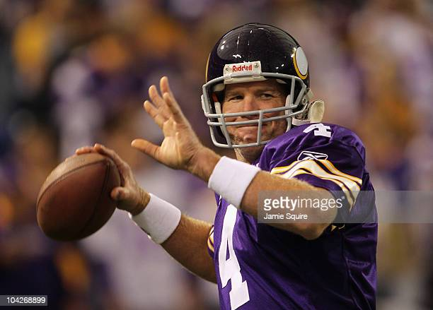 Quarterback Brett Favre of the Minnesota Vikings warms up prior to the start of the game against the Miami Dolphins on September 19 2010 at Hubert H...