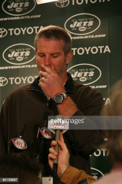 Quarterback Brett Favre of the New York Jets answers questions about his future in the press conference after the game against the Miami Dolphins on...