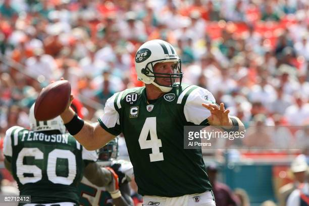 Quarterback Brett Favre of the New York Jets passes the ball against the Miami Dolphins when the Dolphins host the New York Jets in Week One action...