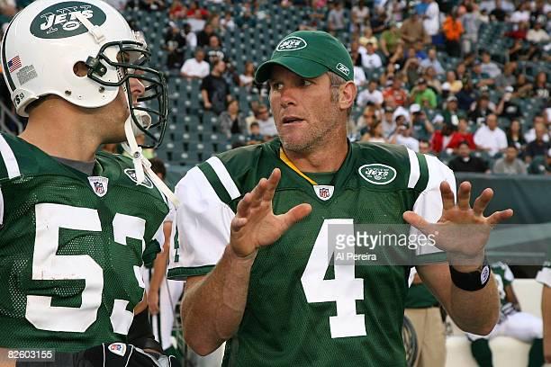 Quarterback Brett Favre of the New York Jets speaks with Linebacker Cody Spencer during the game against the Philadelphia Eagles during a preseason...