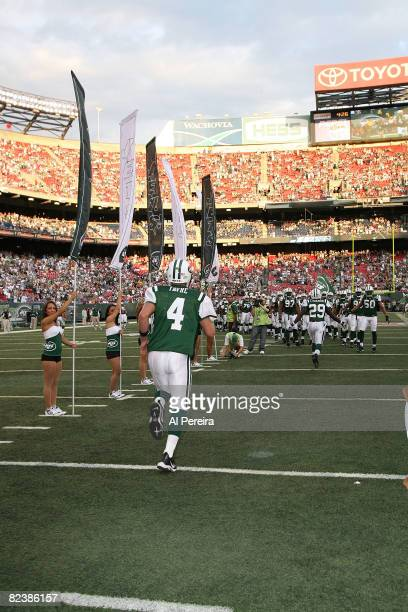Quarterback Brett Favre of the New York Jets takes the field during introductions as the Jets host the Washington Redskins in a preseason game on...