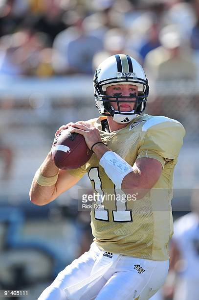Quarterback Brett Hodges of Central Florida Knights drops back to pass against the Memphis Tigers at Bright House Networks Stadium on October 3, 2009...