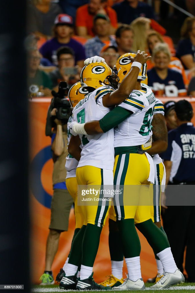 Quarterback Brett Hundley #7 of the Green Bay Packers celebrates a fourth quarter touchdown run with teammates during a Preseason game against the Denver Broncos at Sports Authority Field at Mile High on August 26, 2017 in Denver, Colorado. The Broncos defeated the Packers 20-17.