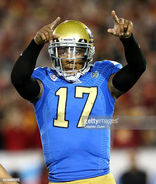 Quarterback Brett Hundley of the UCLA Bruins celebrates a Myles Jack three yard touchdown run in the first quarter against the USC Trojans at Los...