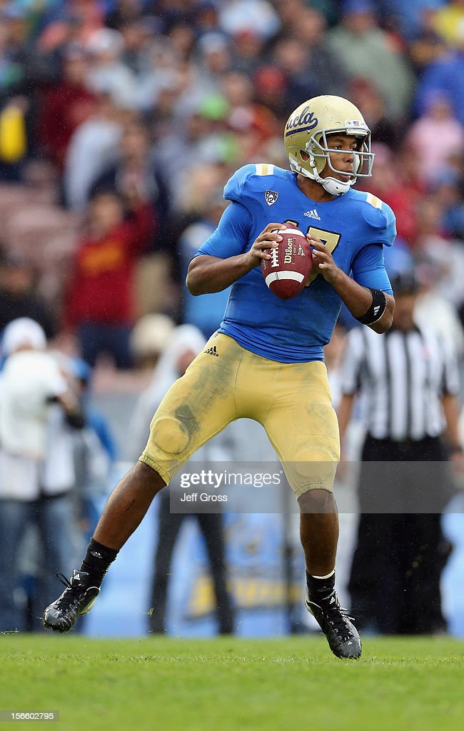 Quarterback Brett Hundley #17 of the UCLA Bruins drops back to pass against the USC Trojans in the first half at the Rose Bowl on November 17, 2012 in Pasadena, California. UCLA defeated USC