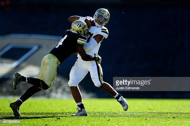 Quarterback Brett Hundley of the UCLA Bruins is tackled by defensive back Chidobe Awuzie of the Colorado Buffaloes during the fourth quarter at...