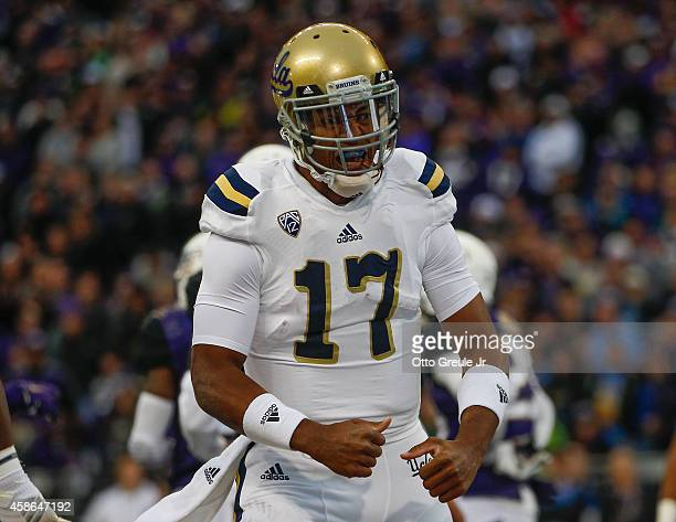Quarterback Brett Hundley of the UCLA Bruins reacts after scoring a touchdown in the first quarter against the Washington Huskies on November 8, 2014...