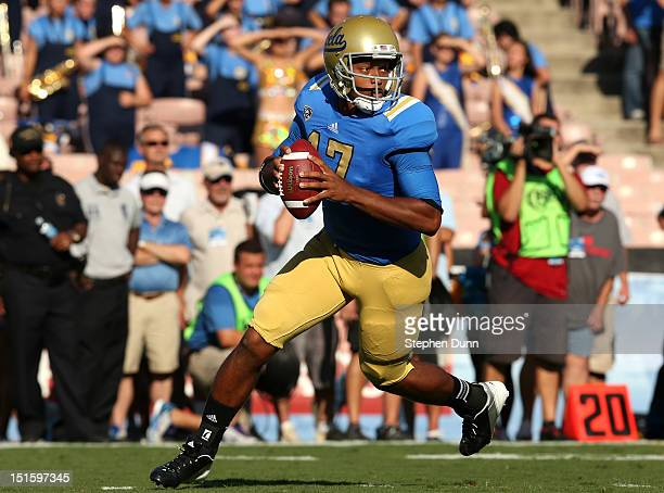 Quarterback Brett Hundley of the UCLA Bruins rolls out against the Nebraska Cornhuskers at the Rose Bowl on September 8 2012 in Pasadena California