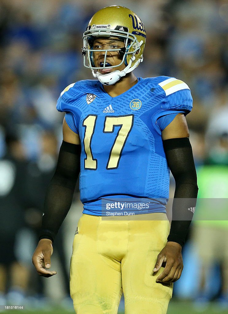Quarterback Brett Hundley #17 of the UCLA Bruins shouts to his teammates in the game against the New Mexico State Aggies at the Rose Bowl on September 21, 2013 in Pasadena, California. UCLA won 59-13.