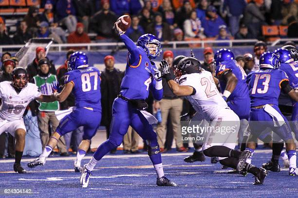 Quarterback Brett Rypien of the Boise State Broncos gets a pass off under pressure from linebacker Matt Lea of the UNLV Rebels during second half...