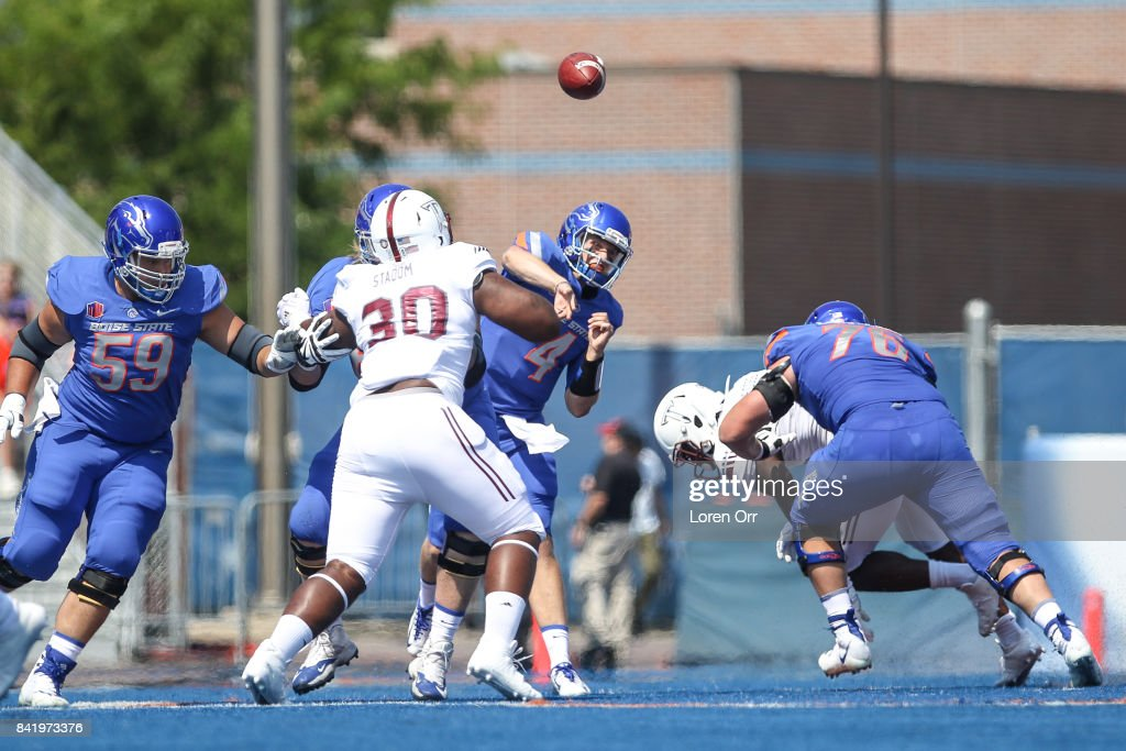Quarterback Brett Rypien #4 of the Boise State Broncos makes a pass attempt during first half action against the Troy Trojans on September 2, 2017 at Albertsons Stadium in Boise, Idaho.